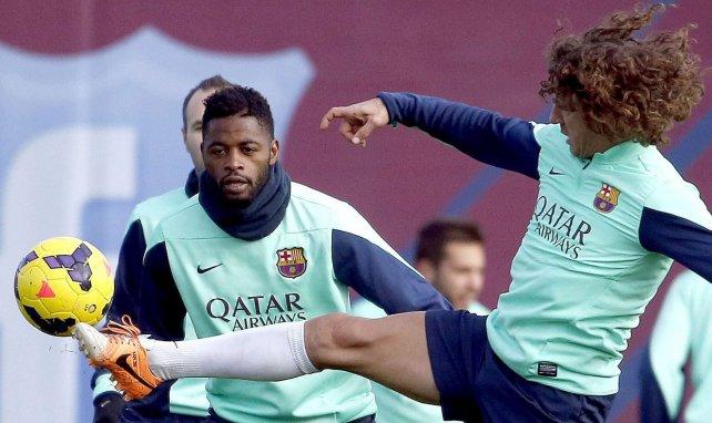 Alexandre Song avec Carles Puyol lors d'un entraînement du FC Barcelone