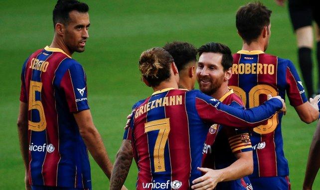 Antoine Griezmann célèbre un but aux côtés de Lionel Messi