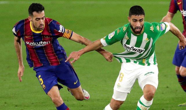 Nabil Fekir à la lutte avec Sergio Busquets
