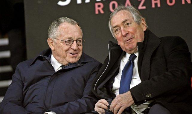 Gérard Houiller assis aux côtés de Jean-Michel Aulas