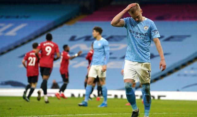 Oleksandr Zinchenko et Manchester City tête basse après la défaite dans le derby