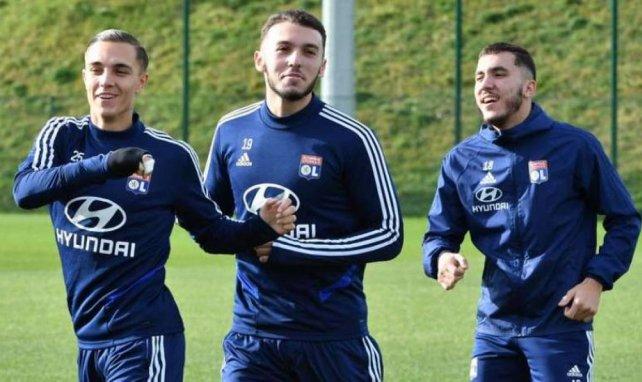 Amine Gouiri (au centre) avec Maxence Caqueret et Rayan Cherki à ses côtés