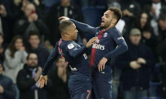 Layvin Kurzawa fête son but contre Montpellier avec Kylian Mbappé