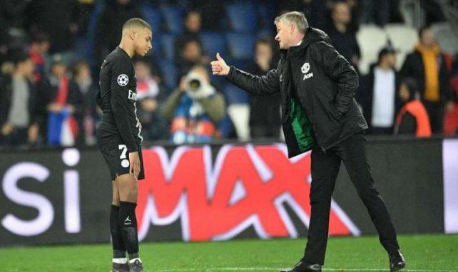 Ole Gunnar Solskjaer et Kylian Mbappé après PSG-Manchester United en Ligue des Champions