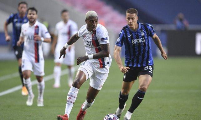 Mario Pašalić face à Presnel Kimpembe lors d'Atalanta-PSG