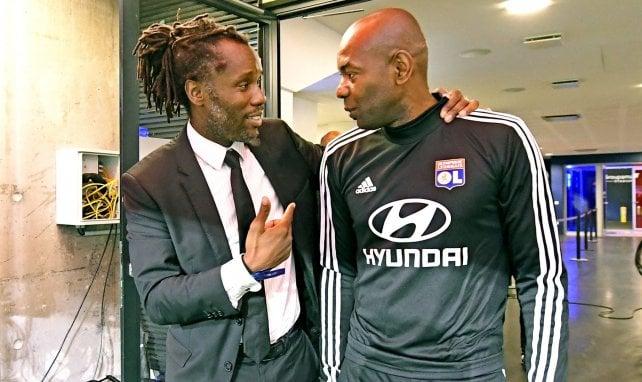 Peguy Luyindula discute avec Claudio Caçapa avant Dijon-OL