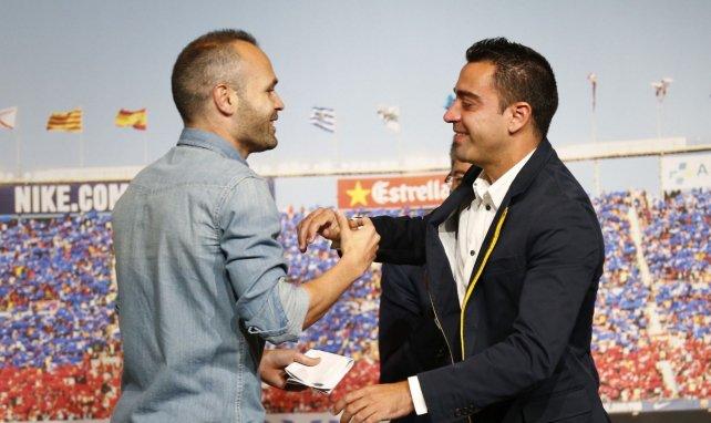 Andrés Iniesta voit Xavi entraîner le FC Barcelone