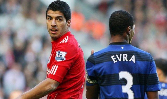 Luis Suarez et Patrice Evra lors d'un choc entre Liverpool et Manchester United